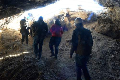 Scott Sommerdorf   |  The Salt Lake Tribune Hikers on the cave tour leave the second cave visited - Jukebox Cave - near Wendover, Saturday, November 14, 2015.