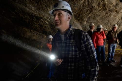 Scott Sommerdorf      The Salt Lake Tribune Chris Woodford of South Jordan looks at cave art inside Danger Cave near Wendover, Saturday, November 14, 2015.