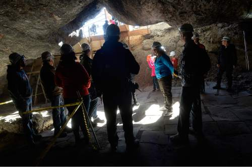 Scott Sommerdorf   |  The Salt Lake Tribune Hikers pause to listen to Justina Parsons-Bernstein describe various features inside Danger Cave near Wendover, Saturday, November 14, 2015.