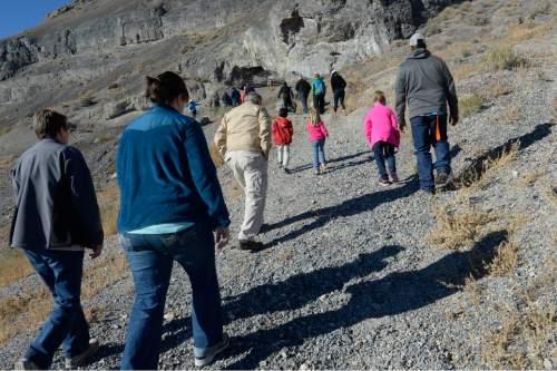 Scott Sommerdorf      The Salt Lake Tribune  Hikers begin the short climb up to Danger Cave near Wendover, Saturday, November 14, 2015.