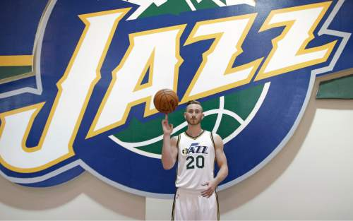 FILE - This Sept. 28, 2015, file photo, shows Utah Jazz's Gordon Hayward (20) posing for a photograph during an NBA basketball media day, in Salt Lake City. The Utah Jazz find themselves in a bit of a predicament on the eve of the 2015-16 NBA season. General manager Dennis Lindsey kept the core of the team together after a strong finish to last season. He stuck to the slow rebuild philosophy and resisted the temptation spend lavishly in free agency.(AP Photo/Rick Bowmer, File)