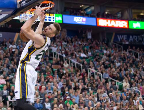 Lennie Mahler  |  The Salt Lake Tribune  Utah guard Gordon Hayward slams the ball on a fast break in the first half of a game against the Memphis Grizzlies at Vivint Smart Home Arena on Saturday, Nov. 7, 2015.