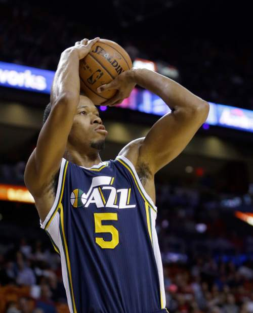 Utah Jazz guard Rodney Hood (5) shoots against the Miami Heat in the first half of an NBA basketball game, Thursday, Nov. 12, 2015, in Miami. (AP Photo/Alan Diaz)