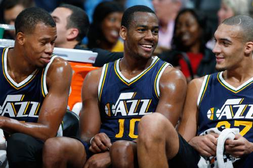 From left, Utah Jazz guards Rodney Hood and Alec Burks joke with center Rudy Gobert, of France, as time runs out during the second half of an NBA basketball game against the Denver Nuggets on Thursday, Nov. 5, 2015, in Denver. Utah won 96-84. (AP Photo/David Zalubowski)