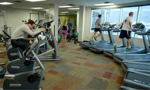Francisco Kjolseth | The Salt Lake Tribune Employees of CHG Healthcare Services near Big Cottonwood Canyon exercise in the Fitness Center. For a story on great places to work.