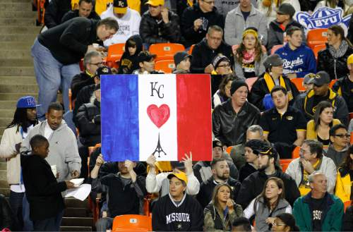 Fans show their support for France following the terrorist attack as they watch Missouri play BYU in the first half of a college football game at Arrowhead Stadium, Saturday, Nov. 14, 2015, in Kansas City, Mo. (AP Photo/Colin E. Braley)