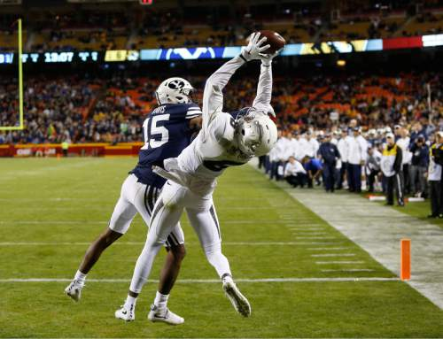 Missouri wide receiver J'Mon Moore (6) catches a pass to score the go-ahead touchdown as BYU defensive back Michael Davis (15) defends in the second half of a college football game at Arrowhead Stadium, Saturday, Nov. 14, 2015, in Kansas City, Mo. Missouri defeated BYU 20-16. (AP Photo/Colin E. Braley)