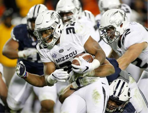 Missouri running back Russell Hansbrough (32) rushes for yardage against BYU in the second half of a college football game at Arrowhead Stadium, Saturday, Nov. 14, 2015, in Kansas City, Mo. Missouri beat BYU 20-16.  (AP Photo/Colin E. Braley)
