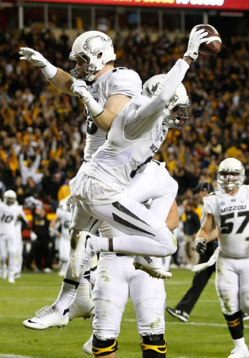 Missouri wide receiver J'Mon Moore, right, celebrates scoring the go-ahead touchdown with wide receiver Wesley Leftwich, left, in the second half of a college football game at Arrowhead Stadium, Saturday, Nov. 14, 2015, in Kansas City, Mo. Missouri defeated BYU 20-16. (AP Photo/Colin E. Braley)