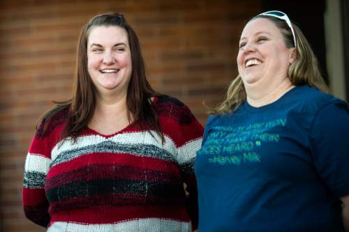 Chris Detrick  |  The Salt Lake Tribune April Hoagland and Beckie Peirce smile during a press conference outside of the Juvenile Court in Price, Utah Friday November 13, 2015. Seventh District Juvenile Judge Scott Johansen has amended an order to remove a 9-month-old girl from the Price home of her same-sex foster parents and has instead scheduled a hearing on the matter.