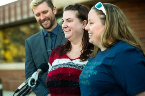 Chris Detrick  |  The Salt Lake Tribune April Hoagland, Beckie Peirce and Equality Utah Executive Director Troy Williams smile during a press conference outside of the Juvenile Court in Price, Utah Friday November 13, 2015. Seventh District Juvenile Judge Scott Johansen has amended an order to remove a 9-month-old girl from the Price home of her same-sex foster parents and has instead scheduled a hearing on the matter.