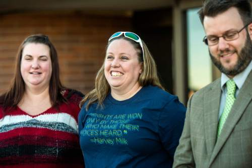 Chris Detrick  |  The Salt Lake Tribune April Hoagland, Beckie Peirce and their attorney Jim Hunnicutt, smile during a press conference outside of the Juvenile Court in Price, Utah Friday November 13, 2015. Seventh District Juvenile Judge Scott Johansen has amended an order to remove a 9-month-old girl from the Price home of her same-sex foster parents and has instead scheduled a hearing on the matter.