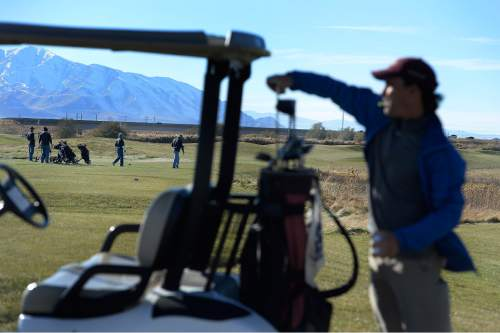Scott Sommerdorf   |  The Salt Lake Tribune Golfer Shane Barrow, foreground, chose to play Wingpointe on it's final day of operation, Sunday, November 15, 2015. The Wingpointe Golf Course will close at the end of business on Sunday, November 15. The golf course property will be returned to the Salt Lake City Department of Airports by the end of December 2015.