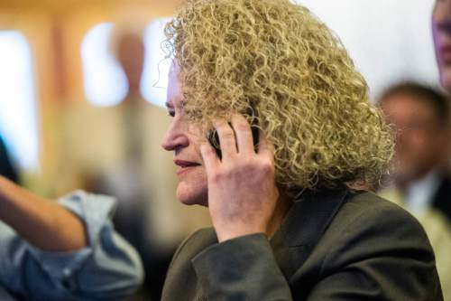 Chris Detrick  |  The Salt Lake Tribune Jackie Biskupski talks with Mayor Ralph Becker on the phone before a election canvass event at City Hall Tuesday November 17, 2015. Jackie Biskupski is the mayor-elect of Salt Lake City.