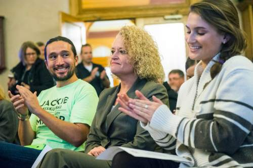Chris Detrick  |  The Salt Lake Tribune Transition team members Matthew Rojas and Simone Butler clap as Jackie Biskupski as announced the winner during a election canvass event at City Hall Tuesday November 17, 2015. Jackie Biskupski is the mayor-elect of Salt Lake City.