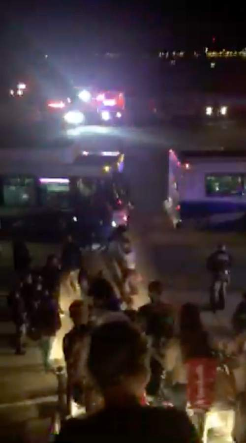 In this image made from a video, passengers exit an Air France plane that was diverted to Salt Lake City International Airport, Tuesday, Nov. 17, 2015, in Salt Lake City. Two Air France flights bound for Paris from the U.S. had to be diverted because of anonymous threats received, but both planes landed safely in North America, officials said. (Keith Rosso via AP) MANDATORY CREDIT