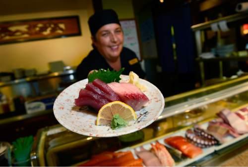 Scott Sommerdorf   |  The Salt Lake Tribune Chef Peggy Whiting (formerly of Ichiban Sushi) with a fresh order of sashimi at Kyoto in Salt Lake City