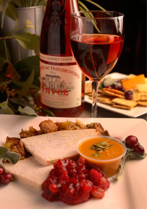 Leah Hogsten  |  The Salt Lake Tribune Chateau De Trinquevedel 2014, $20.99 is served with sliced turkey, cranberry Orange Chutney and harvest pumpkin soup. Wine educator Sheral Schowe talks about French wines and suggests a variety of bottles that go with a Thanksgiving meal,Tuesday, November 10, 2015.