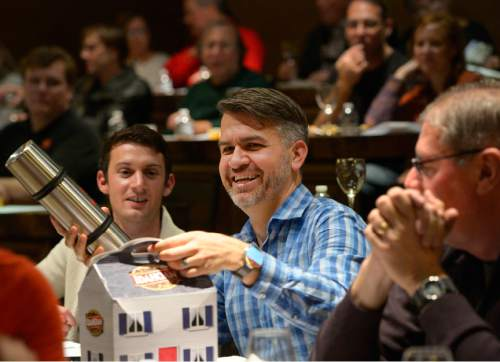 Leah Hogsten  |  The Salt Lake Tribune Ben Tolman (center) and Juden Blake (left) collect prizes for participating in the event. Wine educator Sheral Schowe talks about French wines and suggests a variety of bottles that go with a Thanksgiving meal,Tuesday, November 10, 2015.