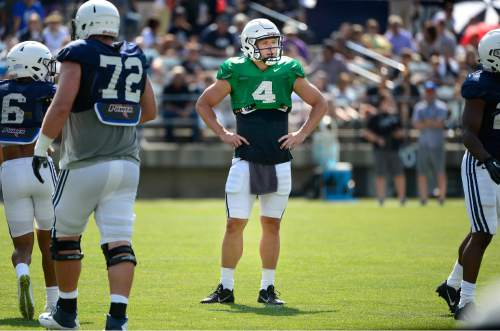 Scott Sommerdorf   |  The Salt Lake Tribune BYU Quarterback Taysom Hill waits for the play call during practice, Saturday, August 22, 2015.
