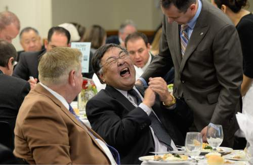 Francisco Kjolseth  |  Tribune File Photo Greg Hughes, right, newly elected speaker of the House, gets a laugh out of Salt Lake County Councilman Randy Horiuchi who is retiring and was being honored during a luncheon on Wednesday, Dec. 17, 2014.