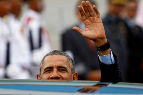 U.S. President Barack Obama waves upon arriving at Subang Airbase in Kuala Lumpur, Malaysia, Friday, Nov. 20, 2015. Obama is in Malaysia where he joins leaders from Southeast Asia to discuss trade and economic issues, and terrorism and disputes over the South China Sea. (AP Photo/Joshua Paul)