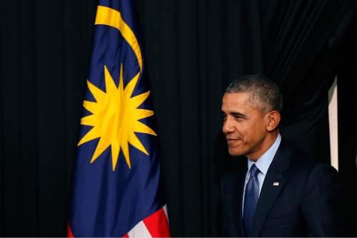 U.S. President Barack Obama arrives for a town hall event in Kuala Lumpur, Malaysia, Friday, Nov. 20, 2015. President Obama is in Malaysia where he will join leaders from Southeast Asia to discuss trade and economic issues, and terrorism and disputes over the South China Sea. (AP Photo/Vincent Thian)