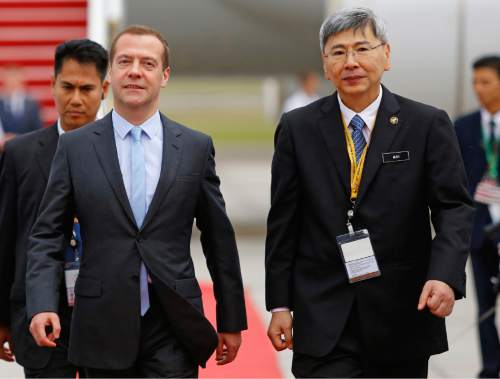 Russia's Prime Minister Dmitry Medvedev, left, walks with Malaysian Minister in Prime Minister Department Mah Siew Keong as he arrives for the 27th Association of Southeast Asian Nations (ASEAN) summit, in Sepang, Malaysia, Friday, Nov. 20, 2015. (AP Photo/Lai Seng Sin)