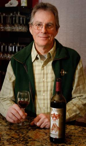 Rick Egan   |  The Salt Lake Tribune  The Kiler Grove Winery co-owner, Michael Knight,  with a glass of wine in the tasting room of his business in South Salt Lake,  Thursday, February 10, 2011.