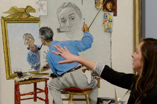 """Trent Nelson     The Salt Lake Tribune Kylie Brooks talks about Norman Rockwell's """"Triple Self-Portrait"""", on display at the BYU Museum of Art in Provo, as part of the show """"American Chronicles: The Art of Norman Rockwell?,"""" a major touring exhibit featuring 50 original Rockwell paintings, as well as all 323 of his Saturday Evening Post covers. Thursday November 19, 2015."""