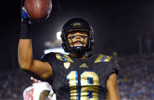 UCLA wide receiver Thomas Duarte celebrates after making a catch for two point conversion during the second half of an NCAA college football game against Washington State, Saturday, Nov. 14, 2015, in Pasadena, Calif. Washington won 31-27. (AP Photo/Mark J. Terrill)