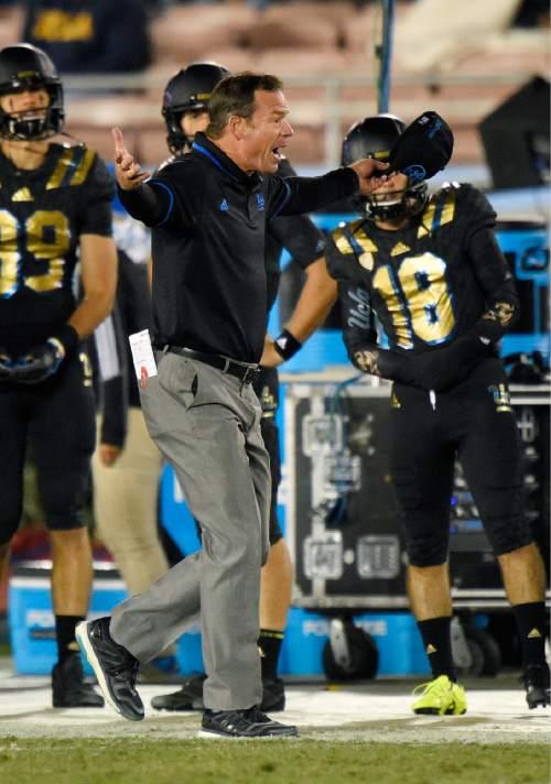 UCLA head coach Jim Mora yells as he walks the sideline during the second half of an NCAA college football game against Washington State, Saturday, Nov. 14, 2015, in Pasadena, Calif. Washington won 31-27. (AP Photo/Mark J. Terrill)