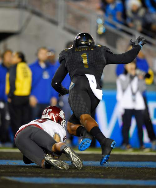 Washington State wide receiver Gabe Marks, makes a touchdown catch as UCLA defensive back Ishmael Adams defends during the second half of an NCAA college football game, Saturday, Nov. 14, 2015, in Pasadena, Calif. Washington won 31-27. (AP Photo/Mark J. Terrill)