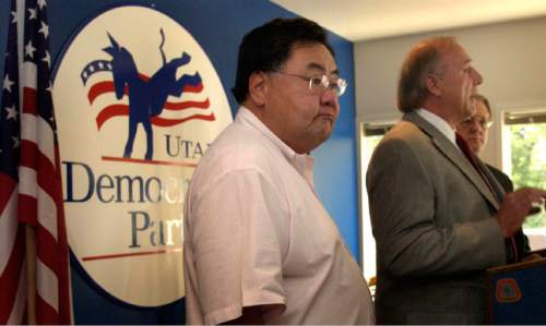 Leah Hogsten  |  Tribune File Photo  Salt Lake County council Democratic councilmen Jim Bradley(middle), Joe Hatch (right) and Randy Horiuchi (left)called for Mayor Nancy Workman to resign her position Monday at the Democratic Party offices in SLC. Oct. 4, 2004.