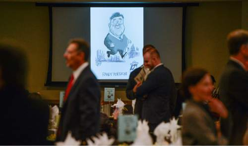 Francisco Kjolseth  |  Tribune File Photo  A picture by Salt Lake Tribune editorial cartoonist Pat Bagley greets elected office-holders and political officials gathered to honor the career and retirement of Salt Lake County Councilman Randy Horiuchi on Wed. Dec. 17, 2014.