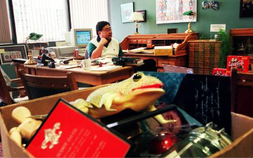 Danny Chan La  |  Tribune File Photo  Commissioner Randy Horiuchi sits in his office as boxes of his personal memorabilia get packed away.