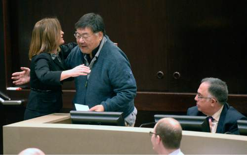 Al Hartmann  |  Tribune File Photo  Incoming Salt Lake County Council member Jenny Wilson, left, gives a hug to friend and mentor councilman Randy Horiuchi at his last meeting Monday January 5, 2015.