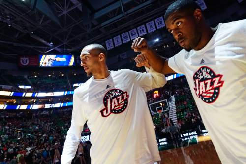 Lennie Mahler  |  The Salt Lake Tribune  Utah center Rudy Gobert and forward Derrick Favors bump fists during player introductions before a game against the Memphis Grizzlies at Vivint Smart Home Arena on Saturday, Nov. 7, 2015.