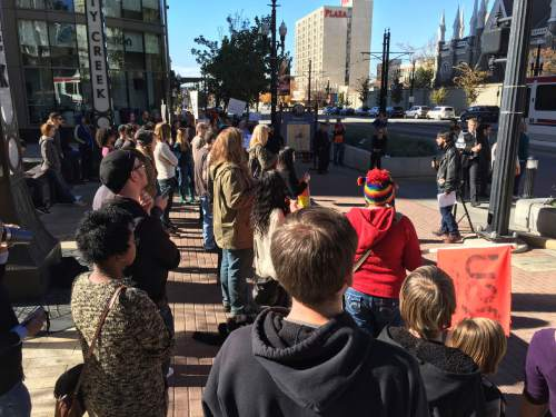 Courtesy  |  Mike Fessler, KUTV  Dozens of people gathered Sunday to protest the new LDS Church policy regarding gay couples and their children.