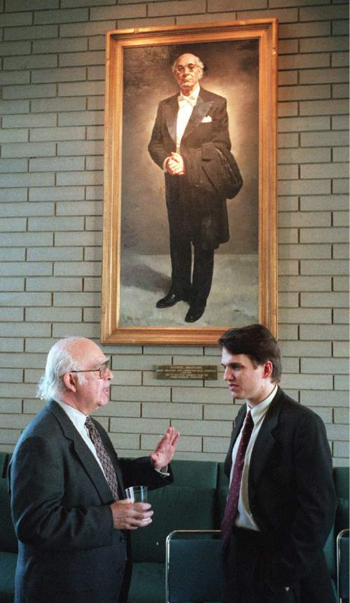 Steve Griffin  |  Salt Lake Tribune  Outgoing Utah Symphony music director Joseph Silverstein talks with his successor, Keith Lockhart, during a January 1998 news conference in front of a portrait of Maurice Abravanel, who led the orchestra from 1947 to 1979.