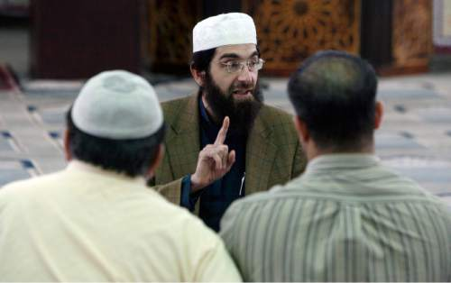 "Francisco Kjolseth  |  The Salt Lake Tribune Imam Muhammed S. Mehtar of the Islamic Society of Great Salt Lake in West Valley City leads a discussion following prayers on Monday, May 2, 2011, following the announcement of Osama bin Laden's death. Imam Mehtar emphasized ""Be honest in everything you do,"" during the discussion with the small group gathered for prayers."