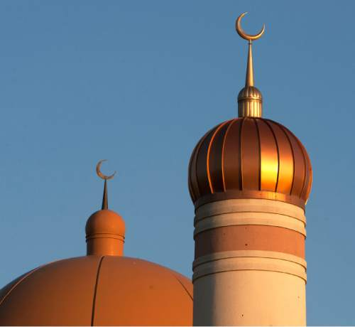 Steve Griffin | The Salt Lake Tribune   Crescent moon spires rise from the minaret, right, and dome at the Khadeeja Islamic Center in West Valley City, Utah Sunday July 21, 2013.