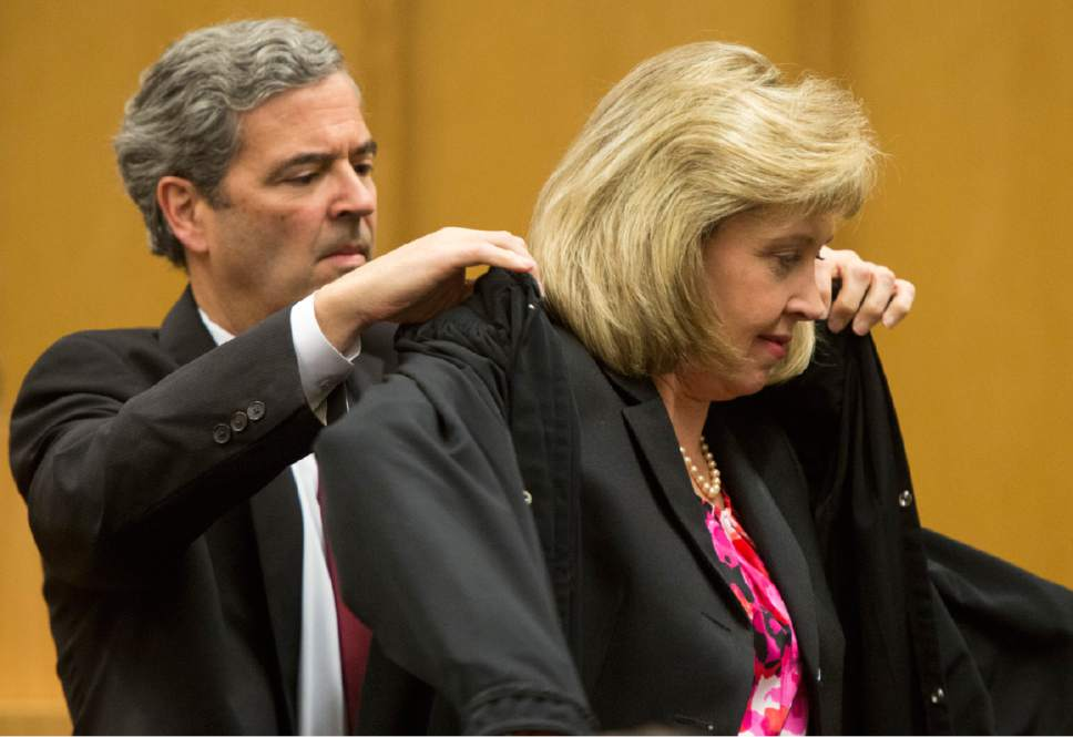 Rick Egan  |  The Salt Lake Tribune  Blake Parrish performs the Presentation of the Robe to his wife, Jill N. Parrish, during her investiture as a new federal judge, at the Federal Court Room, Monday, November 23, 2015.