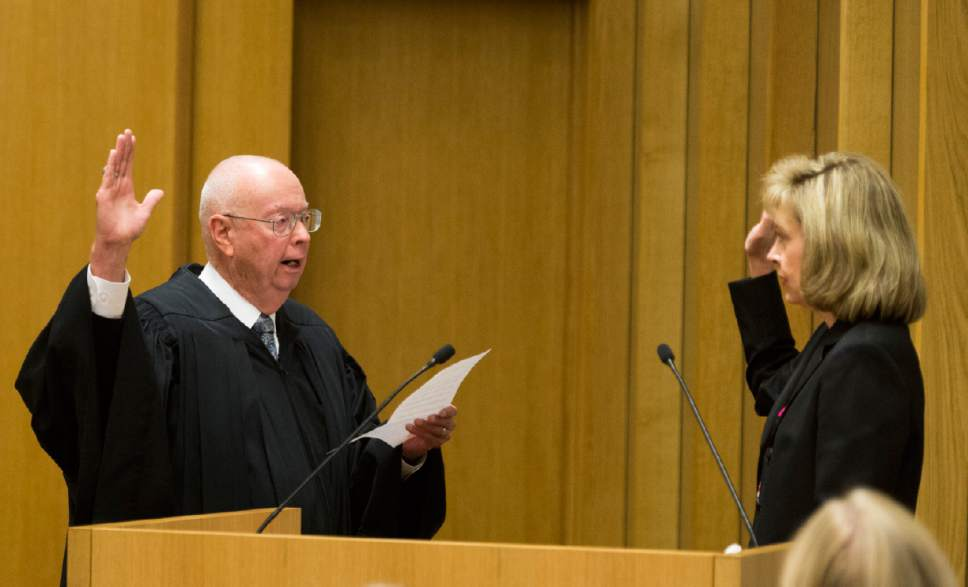 Rick Egan  |  The Salt Lake Tribune  The Honorable Dale A. Kimball, Senior District Judge, reads the Oath of Office to Jill N. Parrish, during her investiture as a new federal judge, at the Federal Court Room, Monday, November 23, 2015.