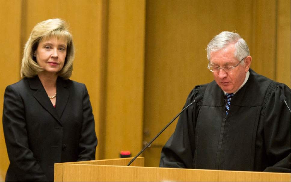 Rick Egan  |  The Salt Lake Tribune  Jill N. Parrish listens as Honorable Clark Waddoups reads the commission, during her investiture as a new federal judge, at the Federal Court Room, Monday, November 23, 2015.