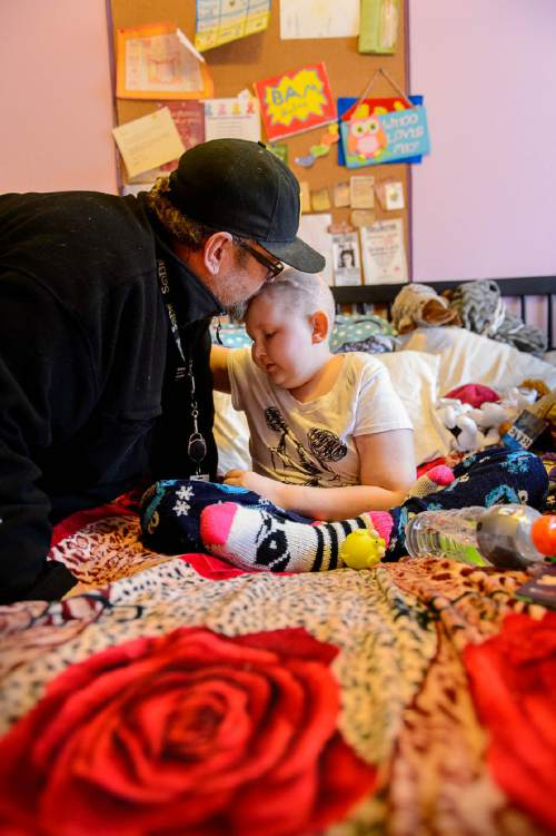 Trent Nelson  |  The Salt Lake Tribune BayLee Parks gets a kiss from her father, Jimmy Parks, in her Midvale bedroom Nov. 17. Parks, 17, is getting her affairs in order. She was diagnosed at age 10 with Medulloblastoma and rather than undergo yet another round of chemotherapy, she's decided to stop treatment.