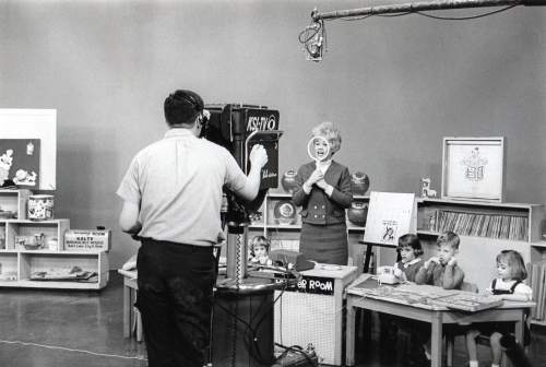 "Courtesy photo | Edna Anderson-Taylor looks through her ""magic mirror"" while taping Romper Room. Anderson-Taylor played Miss Julie on the local version of Romper Room in the 1960s and 1970s."