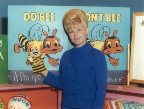 Courtesy photo | Edna Anderson-Taylor poses with the Do Bee puppett on the set of children's TV show Romper Room. Anderson-Taylor played Miss Julie on the local version of Romper Room in the 1960s and 1970s.