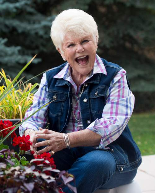 "Rick Egan  |  The Salt Lake Tribune  Edna Anderson-Taylor, loves working in her garden.  Taylor, known by many as ""Miss Julie"" from her 17 years as host of the ""Romper Room"" children's television show, Tuesday, November 3, 2015."