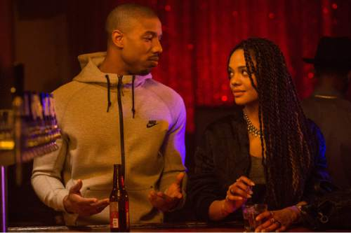 """This photo provided by Warner Bros. Pictures shows Michael B. Jordan, left, as Adonis Johnson and Tessa Thompson as Bianca in Metro-Goldwyn-Mayer Pictures', Warner Bros. Pictures' and New Line Cinema's drama """"Creed,"""" a Warner Bros. Pictures release. (Barry Wetcher/Warner Bros. Pictures via AP)"""